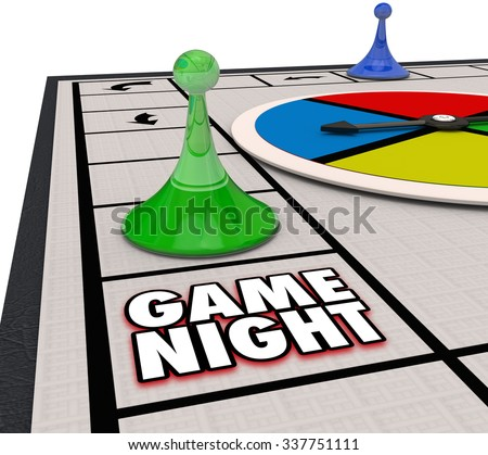 Game Night words on a board game with pieces moving around in fun competition - stock photo