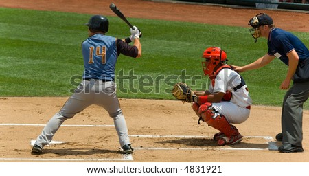 Game of baseball played by young men - stock photo