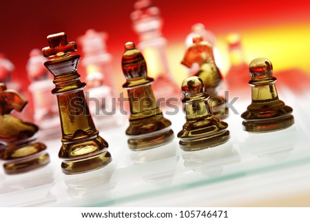 Game of glass chess pieces - stock photo