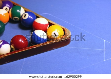 Game of pool (billiard) on a blue table - stock photo