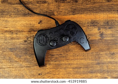 Game pad controller on wooden desk, flat lay top view, gaming and entertainment concept with copy space - stock photo