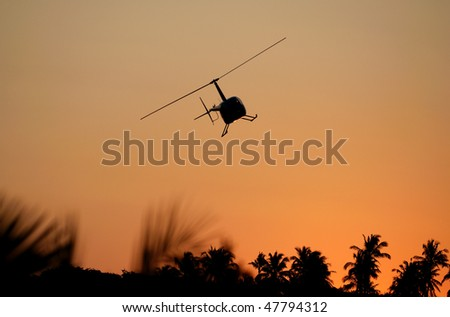 Game Viewing Helicopter at Sunset - stock photo