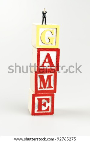 Game word and toy business man - stock photo