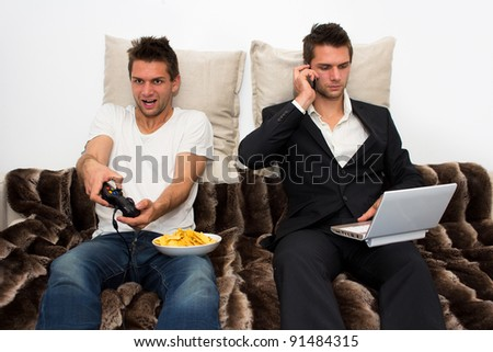 Gamer and Businessman side by side - stock photo