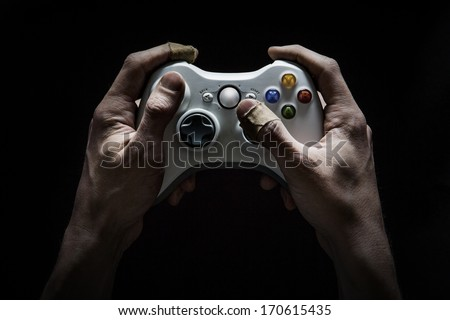 Gaming Addict - Dirty and damaged hands worn from playing too many computer/video games. - stock photo