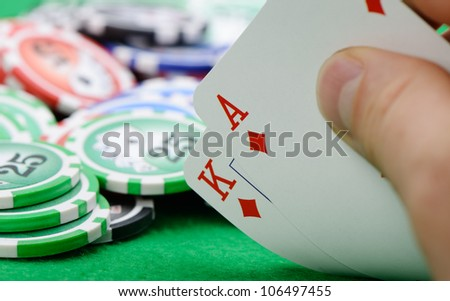 Gaming cards  in hand on the green cloth. A winning combination in Black Jack - stock photo