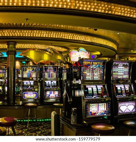 Gaming slot machines in American gambling casino in the cruise liner of Royal Caribbean International, USA - stock photo