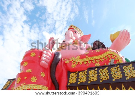 Ganesh sitting on a throne, a sacred Hindu people respect a lot.  - stock photo