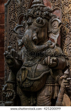 Ganesh wood carving Buddhist temple in Thailand.