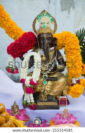 Ganesha worship ceremony,Statue of god Lord Ganesha in a blessing posture with his conch and tools of destruction