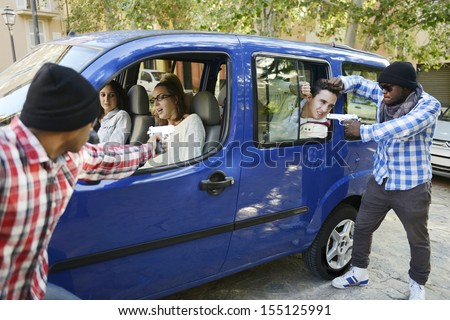 Gang assaulting young people in a car - stock photo