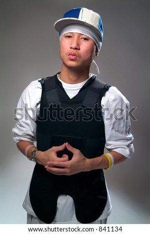 Gang member in a bullet proof vest. - stock photo