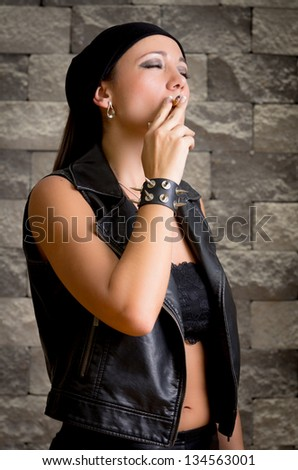 gang woman smokes on the street, selective focus