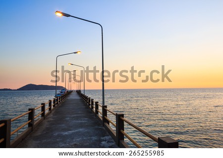Gangplank at sunset with light from a light pole. - stock photo