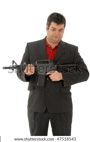 Gangster holding down m4-rifle - stock photo