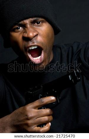 Gangster Holding Gun - stock photo