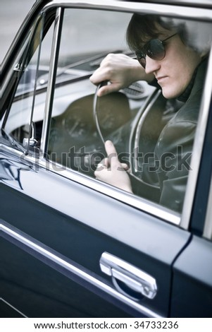 gangster in a car - stock photo