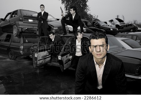 Gangster in action. Multiple shots of the same guy getting out of a demolished car - stock photo