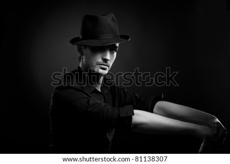 Gangster look. Handsome man with hat. - stock photo