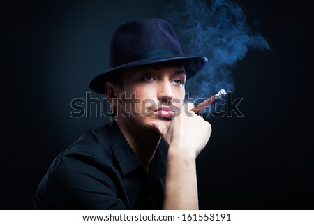 Gangster look. Man with hat and cigar. - stock photo