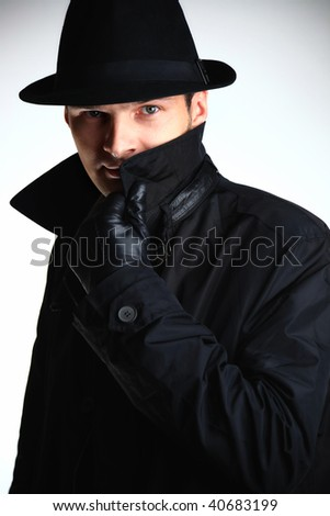 Gangster man in hat - stock photo