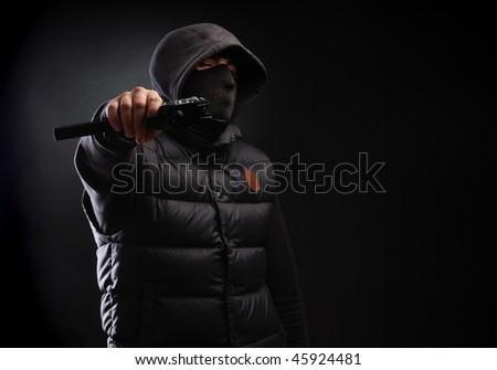 gangster over dark background - stock photo