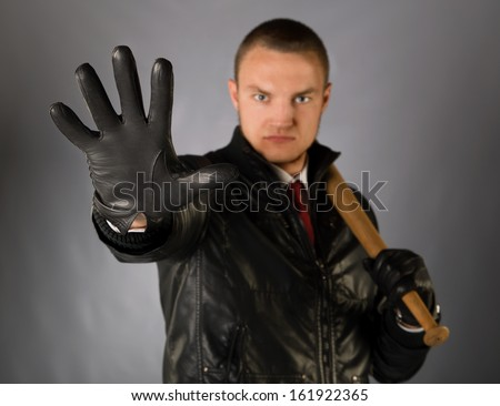 Gangster with a bat - stock photo