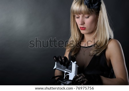 Gangster woman with pistol in black
