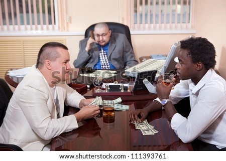 Gangsters in the office with the case of dollars. - stock photo