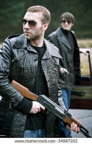 gangsters preparing - stock photo