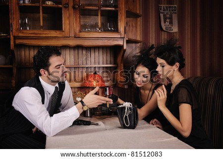 Gangsters who share the loot jewelry. - stock photo