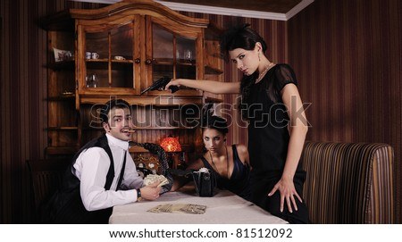 Gangsters who share the money, women wants to shoot the guy. - stock photo