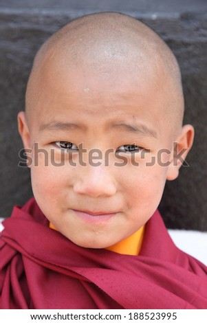 GANGTOK,SIKKIM/ INDIA-april 10:Novice Lama at Enchey Monastery on april 10, 2014 in Gangtok. - stock photo