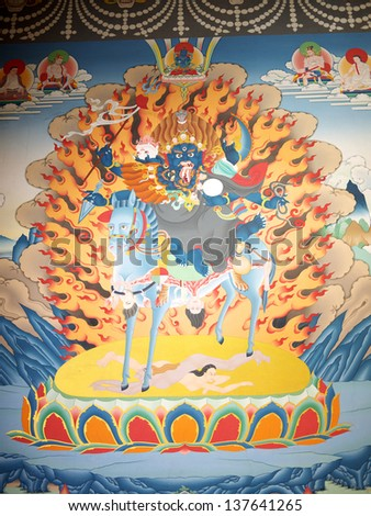 GANGTOK, SIKKIM/ INDIA-APRIL 7: Painting wall in the Ranka (Lingdum or Pal Zurmang Kagyud) Monastery on April 7, 2013 in Gangtok. This prescribes about devil, fire, god, goddess, and Bodhisattva. - stock photo