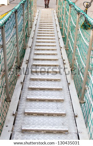 Gangway Between the ports and ship - stock photo