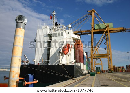 Gantry cranes and Container Ships - stock photo