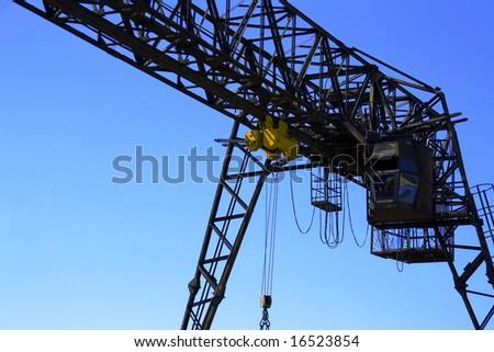 gantry over blue sky - stock photo