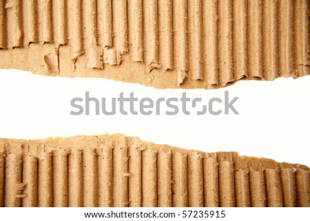 Gap in corrugated cardboard on white background - stock photo