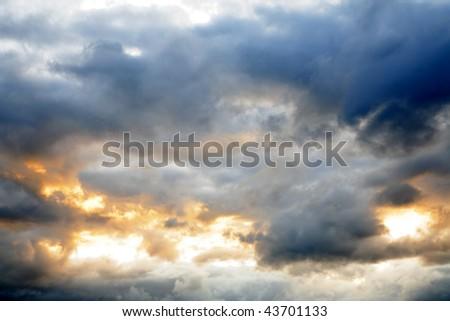 Gap in dark ominous clouds - stock photo