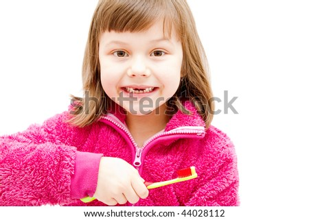 gap toothed girl brushing her teeth isolated on white