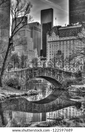Gapstow Bridge is one of the icons of Central Park, Manhattan in New York City. Gapstow stands 12 feet high, spans 44 feet of water, and stretches 76 feet in its full length - stock photo