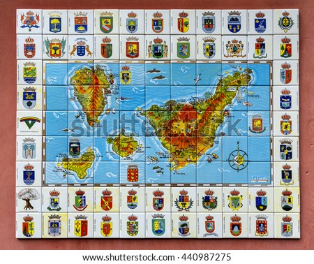 Garachico, Spain - August 16, 2015: Decorative Ceramic shields of the towns of the Canary Islands and plane of the Canary Islands in the Atlantic Ocean - stock photo