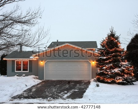 Garage decorated for Christmas in Minnesota - stock photo