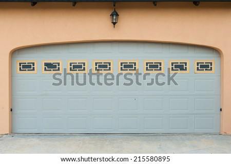 garage door of a detached house - stock photo