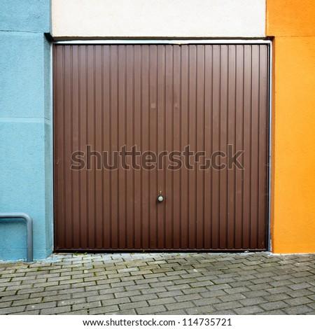 Garage door of an apartment building - stock photo