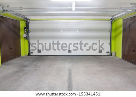 Garage door. Underground garage located under modern house estate block of flats - stock photo