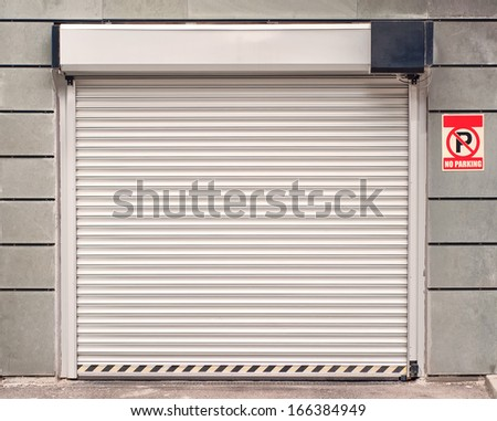 Garage door with no parking sign - stock photo
