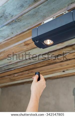 Garage doors installation. Contractor programming a mechanical garage door opener - stock photo