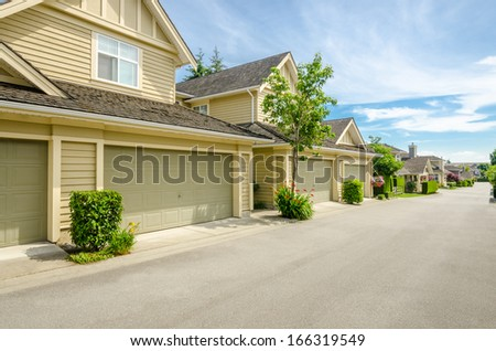 Garage doors of luxury houses in Vancouver, Canada. - stock photo