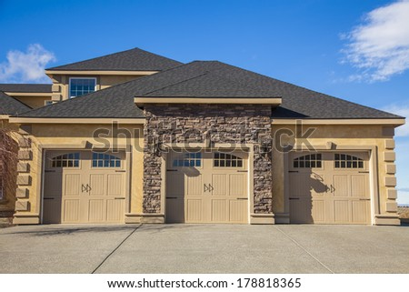 garage doors with windows - stock photo